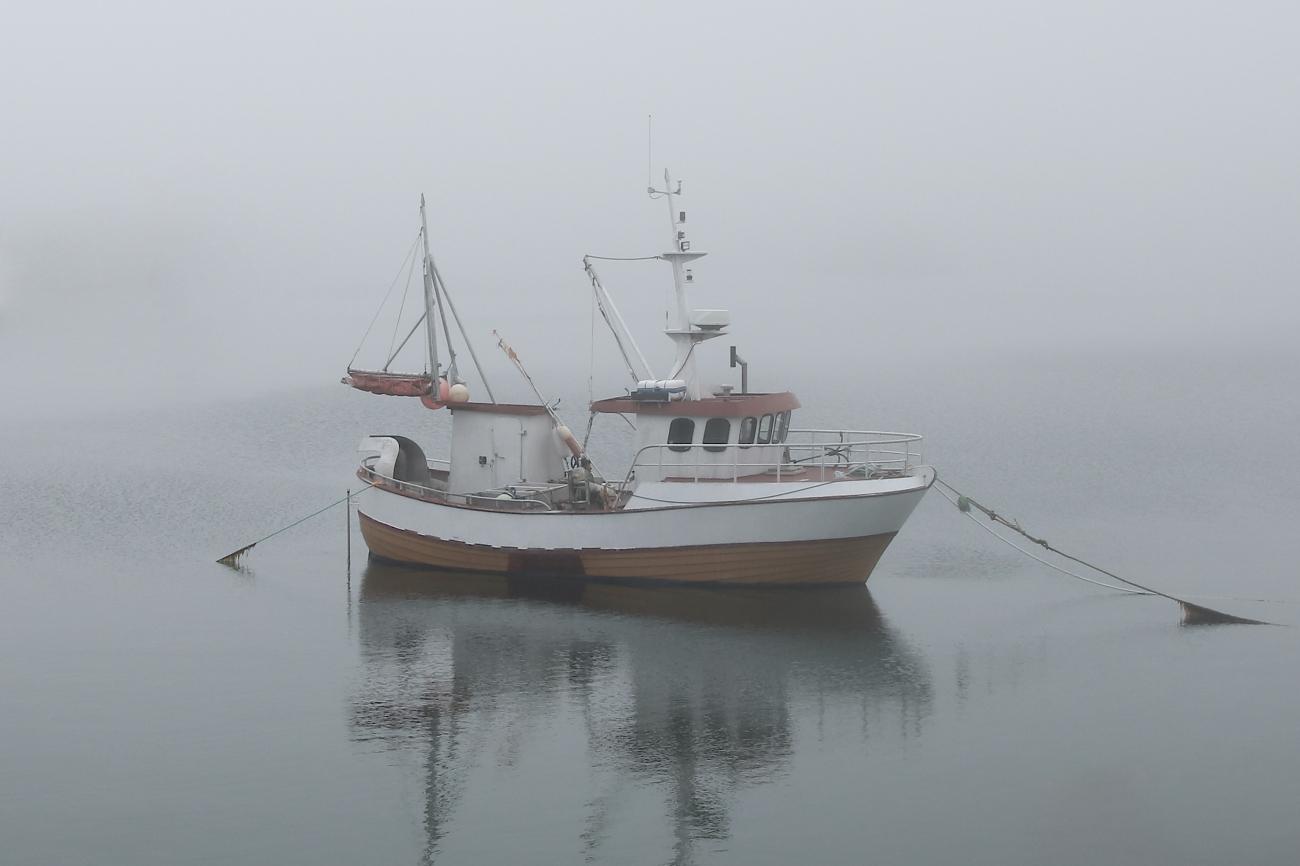 Boat in fog at Moskenes, Lofoten